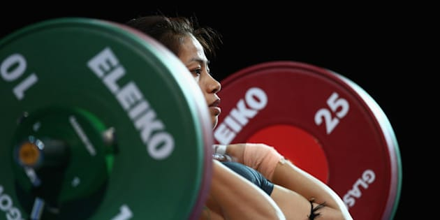 GLASGOW, SCOTLAND - JULY 24:  Sanjita Chanu Khumukcham of India competes in the Clean and Jerk on her way to winning the Gold Medal in the Women's 48kg Weightlifting at the Scottish Exhibition And Conference Centre during day one of the Glasgow 2014 Commonwealth Games on July 24, 2014 in Glasgow, United Kingdom.  (Photo by Paul Gilham/Getty Images)