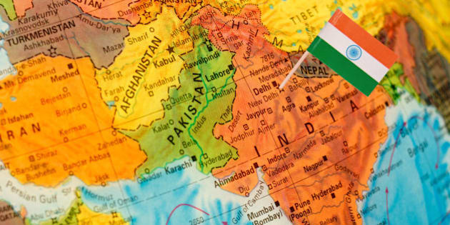 map with miniature flag of India.Selective focus on Indian Flag. Backlit lighting