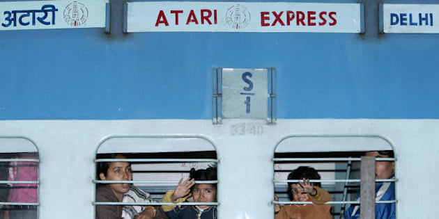 New Delhi, INDIA: Passengers travelling by the Samjhauta Express wave goodbye to relatives at the Old Delhi Railway Station in Delhi, 21 February 2007. The twice-weekly service, Samjhauta Express seen as a symbol of peace between rivals India and Pakistan, was carrying more than 750 Pakistanis and Indians when it was attacked, 19 February killing 68.    AFP PHOTO / Manan VATSYAYANA (Photo credit should read MANAN VATSYAYANA/AFP/Getty Images)