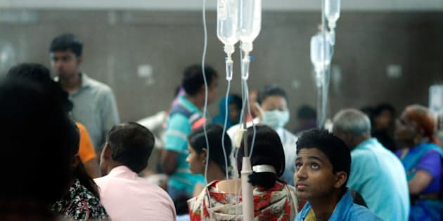 NEW DELHI, INDIA - SEPTEMBER 19: Patients await for routine check-up as they lie under a mosquito net inside a dengue ward of a government hospital, on September 19, 2015 in New Delhi, India. As Delhi battles its worst dengue outbreak in five years, authorities are grappling with complaints of medical negligence and insufficient infrastructure. According to municipal corporation officials, over 2,000 people have tested positive for the vector-borne disease. Delhi remained in the grip of panic over dengue as two minor girls died of it taking the toll to 16 on a day the number of people down with the mosquito-borne fever crossed 2,000 as hospitals across the city continued to reel under acute pressure. Patients struggled to secure beds even as several hospitals have started emptying wards belonging to other departments to accommodate dengue patients. (Photo by Arun Sharma/Hindustan Times via Getty Images)