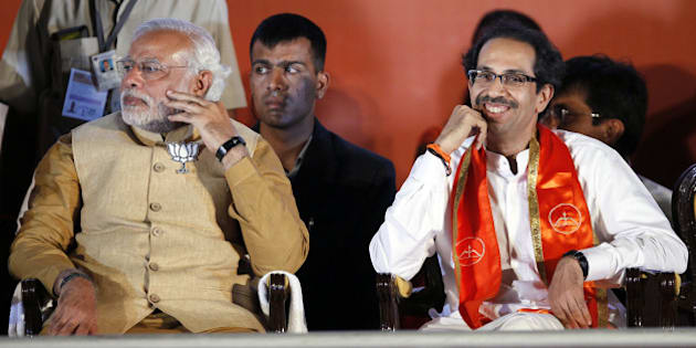 MUMBAI, INDIA - APRIL 21: BJP prime ministerial candidate Narendra Modi (L) with Shiv Sena party chief Uddhav Thackeray during an election rally at MMRDA ground, BKC on April 21, 2014 in Mumbai, India. The main opposition parties of Maharashtra i.e Sena-BJP-RPI have cobbled out grand alliance or Maha-Yuti against ruling Congress-NCP. (Photo by Kunal Patil/Hindustan Times via Getty Images)