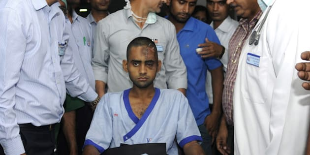 NOIDA, INDIA - OCTOBER 10: Dadri lynching victim Akhlaq's son Danish (22), being shifted to Army Research and Referral (R&R) Hospital in Dhaula Kuan, Delhi, from Kailash Hospital, Noida, on October 10, 2015 in Noida, India. Danish was attacked and Akhlaq was killed by the mob after rumours that the family had consumed and stored beef in their house at Bishara village in Dadri, Uttar Pradesh. (Photo by Sunil Ghosh/Hindustan Times via Getty Images)