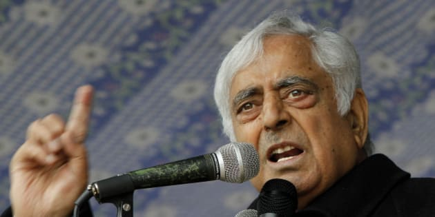 Peoples Democratic Party (PDP) leader Mufti Mohammad Sayeed speaks during an election campaign rally on the outskirts of Srinagar, India, Thursday, April 17, 2014. Several separatist organizations have jointly appealed to the people of Jammu and Kashmir to boycott the Indian parliamentary elections. Nationwide voting began April 7 and runs through May 12, with results for the 543-seat lower house of Parliament to be announced four days later. (AP Photo/Mukhtar Khan)