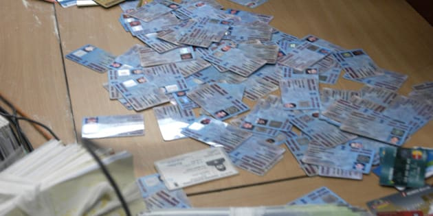INDIA - MARCH 15:  CREDIT CARDS AND PAN CARDS RECOVERED FROM CHEATERS GURPREET SINGH AND SARABJIT SINGH ARRESTED AT PARLIAMENT STREET POLICE STATION ON THURSDAY.  (Photo by Imtiyaz Khan/The India Today Group/Getty Images)