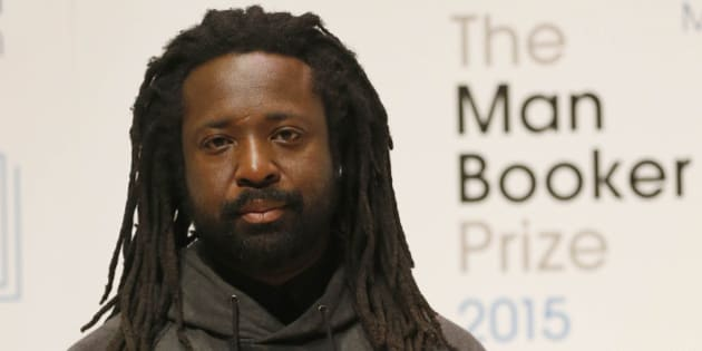 Author Marlon James poses with his book 'A Brief History of Seven Killings' on stage at the Royal Festival Hall in London, Monday, Oct. 12, 2015. James is one of six short-listed authors of the 2015 Man Booker Prize for Fiction.  The winner will be announced Tuesday Oct. 13. (AP Photo/Frank Augstein)
