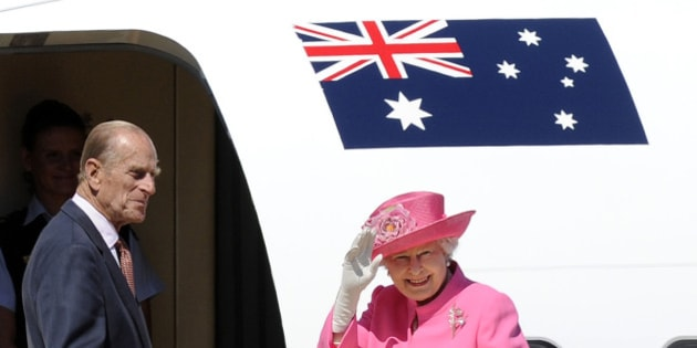 FILE - In this Oct. 26, 2011 file photo, Britain's Queen Elizabeth II, right, and her husband Prince Philip board a plane flying to Perth from Melbourne airport, Australia, on their way to attend the Commonwealth heads of government meeting in Perth. Australia's prime minister on Monday, Jan. 26, 2015 dismissed criticism of his decision to the Duke of Edinburgh an Australian knight, saying Philip has a long history of service Down Under. Prime Minister Tony Abbott's announcement that the duke would be awarded Australia's highest honor came on Australia's national holiday, prompting some to question the wisdom of knighting a British royal on a day meant to commemorate Australians. (AP Photo/Andrew Brownbill, File)