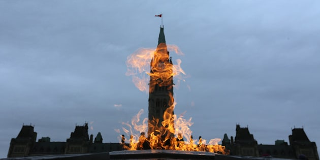 OTTAWA, ON - NOVEMBER 10:The Centennial Flame, lit in 1967 by Lester B. Pearson burns on Parliament Hill. Preparations are under way War Memorial on the eve of Remembrance Day.        (Steve Russell/Toronto Star via Getty Images)