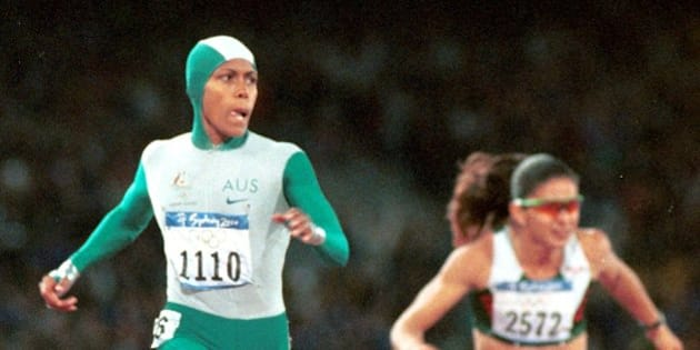 Australia's Cathy Freeman crosses the finish line to win the gold medal in the 400-meter race Monday, Sept. 25, 2000 at Olympic Stadium in Sydney. Mexico's Ana Guevara is at right. (AP Photo/Doug Mills)
