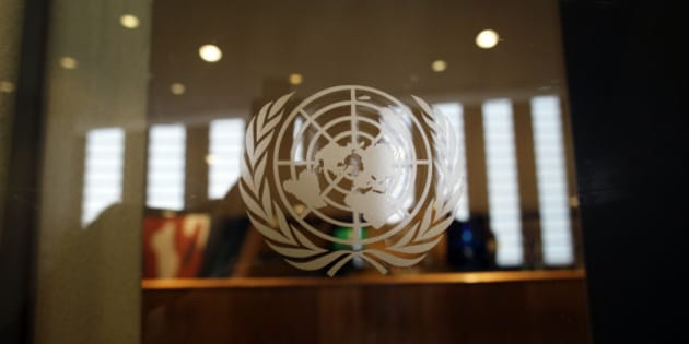 NEW YORK CITY, UNITED STATES - SEPTEMBER 26: Emblem of the United Nations on a glass door at the entrance to the assembly hall at the headquarters of the United Nations on September 26, 2014, in New York City, United States. Photo by Thomas Koehler/Photothek via Getty Images)***Local Caption***