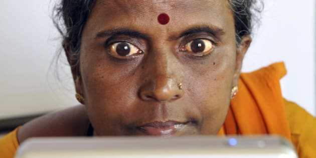 An Indian villager opens up her eyes for iris scanning infront of an Iris Access machine during the data collecting process for a pilot project of The Unique Identification Authority of India (UIDAI) in the village of Chellur, some 145kms north-west of Bangalore on April 22, 2010.   The Unique Identification Authority of India (UIDAI) has been created as an attached office under the Planning Commission. Its role is to develop and implement the necessary institutional, technical and legal infrastructure to issue Unique Identity (UID) numbers to Indian residents.The scheme which will be equivalent of the social security number in the US is designed to leverage intensive usage of the UID for multiple purposes to provide an efficient and convenient mechanism to update information. Photographs and biometric data will be added progressively to make the identification foolproof. Easy registration and information change procedures are envisaged for the benefit of the people. AFP PHOTO/Dibyangshu SARKAR (Photo credit should read DIBYANGSHU SARKAR/AFP/Getty Images)
