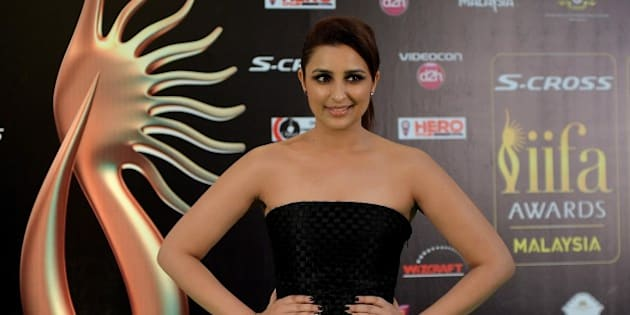 Bollywood Actress Parineeti Chopra poses on the green carpet as she arrives to attend the final day of the 16th International Indian Film Academy (IIFA) Awards at the Putra Stadium in Kuala Lumpur on June 7, 2015.   AFP PHOTO / MANAN VATSYAYANA        (Photo credit should read MANAN VATSYAYANA/AFP/Getty Images)