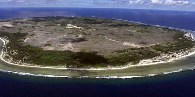 NAURU, NAURU:  The barren and bankrupt island state of the Republic of Nauru awaits the arrival of 521 mainly Afghan refugees, 11 September 2001 which have been refused entry into Australia.  The 25 square kilometres of land which is Nauru, has been devastated by phosphate mining which once made the Micronesian Nauruans the second wealthiest people per capita on earth.      AFP PHOTO/Torsten BLACKWOOD (Photo credit should read TORSTEN BLACKWOOD/AFP/Getty Images)
