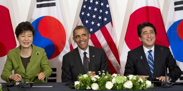 (L-R) South Korean President Park Geun-hye, US President Barack Obama and Japanese Prime Minister Shinzo Abe hold a trilateral meeting at the US ambassador's residence in The Hague on March 25, 2014 after they attended the Nuclear Security Summit (NSS). Obama hosted the much-anticipated first meeting between the Asian leaders with relations between Tokyo and Seoul at their lowest ebb in years, mired in emotive issues linked to Japan's 1910-45 colonial rule and a territorial dispute, as well as Japan's use of South Korean 'comfort women' sex slaves in wartime brothels. AFP PHOTO / Saul LOEB        (Photo credit should read SAUL LOEB/AFP/Getty Images)