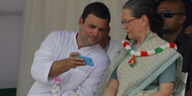 """NEW DELHI, INDIA - SEPTEMBER 20: Congress Vice President Rahul Gandhi and Congress President Sonia Gandhi during the Kisan Samman Rally at Ramlila Maidan on September 20, 2015 in New Delhi, India. During the rally, Sonia Gandhi said, """"This victory is not only the victory of Congress party, it's the victory for all the farmers"""". While Rahul said, every person has mother. There is no one who doesn't have mother. When we cry, we remember our mother, when we are happy, we remember our mother. The Congress organised the rally to greet farmers and party workers for 'forcing' Prime Minister Narendra Modi's government to withdraw the 'draconian' land ordinance. (Photo by Arvind Yadav/Hindustan Times via Getty Images)"""