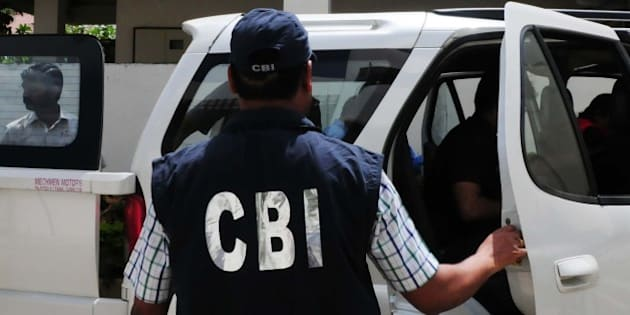 BHOPAL, INDIA - SEPTEMBER 24: CBI officials coming out of the residence of main accused in Vyapam scam Nitin Mahindra after conducting search on September 24, 2015 in Bhopal, India. CBI today carried out search raids at nearly 40 places in Madhya Pradesh and Uttar Pradesh in connection with Vyapam scam. The agency has registered over 105 cases in connection with various aspects of scam. (Photo by Mujeeb Faruqui/Hindustan Times via Getty Images)