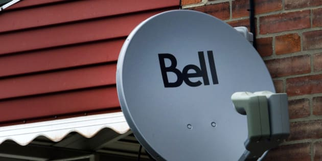 A Bell Canada television satellite is mounted outside of a home in Toronto, Ontario, Canada, on Thursday, July 28, 2011. Bell is Canada's largest communications company, providing telephone services, mobile communications, high-speed Internet and digital television. Photographer: Brent Lewin/Bloomberg via Getty Images
