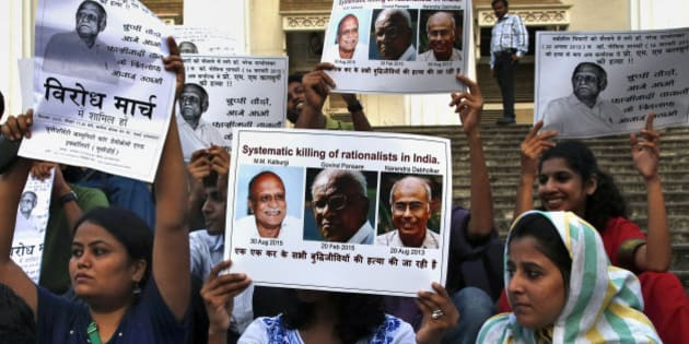 "People hold placards during a protest against the killing of scholar M.M. Kalburgi in Mumbai, India, Tuesday, Sept. 1, 2015. Indian police are investigating the weekend murder of the scholar who was known for his outspoken criticism of idol worship and religious superstition. Placard on left reads, ""Protest March - Step forward and fight against the killing"". (AP Photo/Rajanish Kakade)"