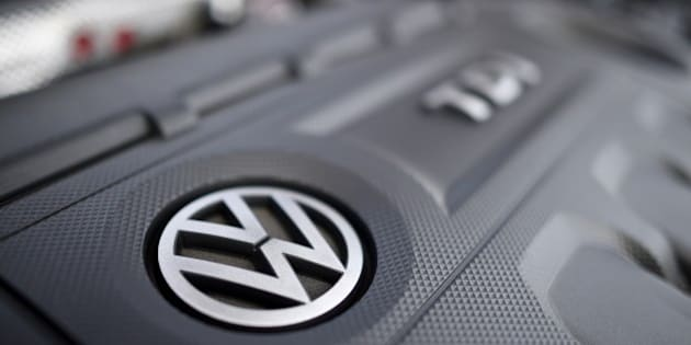 This picture taken on October 15, 2015 in Cardiff shows a Volkswagen logo on the engine of a diesel car. The German authorities tightened the screws on Volkswagen today, saying they would order it to recall 2.4 million vehicles across the country that are fitted with pollution-cheating software.  