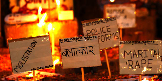 NEW DELHI, INDIA - DECEMBER 16: Placards against rape is pictured beside a memorial at the protestors corner in Jantar Mantar on the second anniversary of the fatal gang-rape of a student on December 16, 2014 in New Delhi, India. On December 16, 2012, a 23-year-old physiotherapy student was brutally gang raped and by six men, including a juvenile, in a moving bus. The incident unleashed a wave of public anger over levels of violence against women in the country. (Photo by Ajay Aggarwal/Hindustan Times via Getty Images)