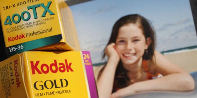 """Boxes of Kodak 35mm film are shown against a box of Kodak inkjet paper for an illustration, Thursday, Jan. 5, 2012 in New York. An uncomfortable suspicion that an icon of American business may have no future pushed investors to dump stock in Eastman Kodak Co. Wednesday. The ailing photography pioneer's shares fell to a new all-time low after the Wall Street Journal reported that Kodak is preparing for a Chapter 11 filing """"in the coming weeks"""" should it fail to sell a trove of 1,100 digital-imaging patents. (AP Photo/Mark Lennihan)"""