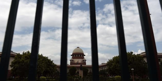 A view of the Indian Supreme Court in New Delhi on July 28, 2015. India's Supreme court refered Yakub Memon's petition against his death sentence for his role in the 1993 Mumbai bomb blasts to a larger bench after a two judge bench delivered a split verdict. AFP PHOTO / SAJJAD HUSSAIN        (Photo credit should read SAJJAD HUSSAIN/AFP/Getty Images)
