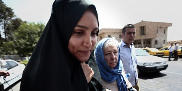 Mary Rezaian (R), the mother of detained Washington Post correspondent Jason Rezaian and his wife Yeganeh Salehi (L) leave the Revolutionary Court after a hearing on August 10, 2015 in the capital Tehran. The trial of 39-year-old Iranian-American journalist, Jason Rezaian who has been in custody for more than a year, resumed behind closed doors, in what could be the final hearing before a judgment is issued on whether he spied on Iran. AFP PHOTO / BEHROUZ MEHRI        (Photo credit should read BEHROUZ MEHRI/AFP/Getty Images)
