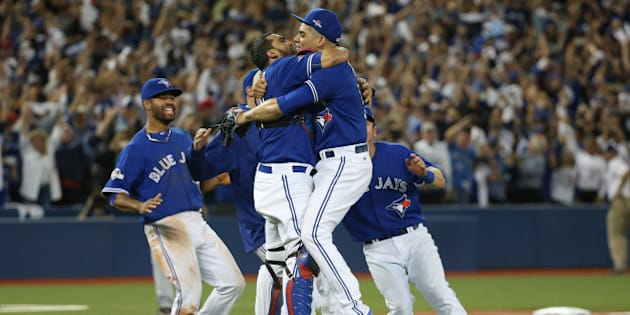 TORONTO, ON- OCTOBER 14:  Roberto Osuna is embraced by catcher Dioner Navarro after recording the save.  The Toronto Blue Jays and Texas Rangers play game five of the MLB American League Division Series . at  Rogers Centre in Toronto.  October 14, 2015.        (Steve Russell/Toronto Star via Getty Images)