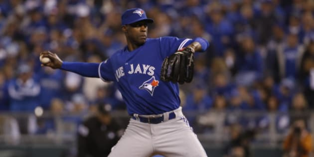 Toronto Blue Jays relief pitcher LaTroy Hawkins throws against the Kansas City Royals during the eighth inning in Game 1 of baseball's American League Championship Series on Friday, Oct. 16, 2015, in Kansas City, Mo. (AP Photo/Matt Slocum)