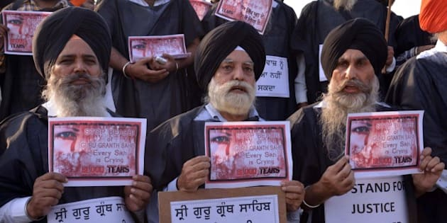 Members of various Sikh organizations hold placards during a 'Punjab bandh' strike in Amritsar on October 15, 2015.  Sikh groups called for a strike following protests that have left two people dead in recent days, over the alleged desecration of a Sikh holy book.   AFP PHOTO/ NARINDER NANU        (Photo credit should read NARINDER NANU/AFP/Getty Images)