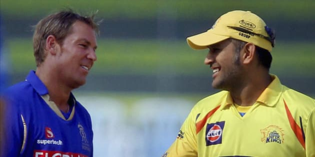 Captains of Rajasthan Royals' Shane Warne, left, and Chennai Super Kings' Mahendra Singh Dhoni interact during the toss before their Indian Premier League (IPL) cricket match in Chennai, India, Wednesday, May 4, 2011. (AP Photo)