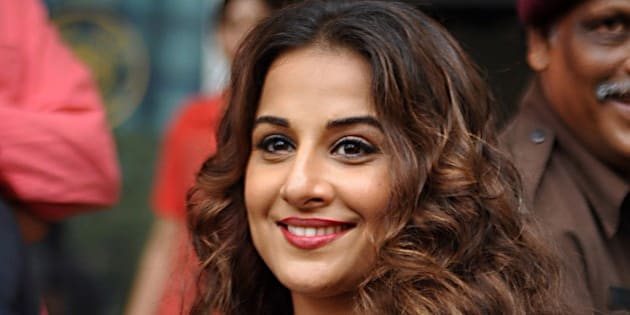Indian Bollywood actress, Vidya Balan inaugurates the exhibition 'Chaplin Lines' to honour the legendary actor, Charlie Chaplin in Mumbai on June 25, 2015. AFP PHOTO        (Photo credit should read STR/AFP/Getty Images)