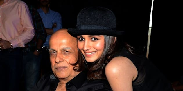 Indian Bollywood film actress Alia Bhatt (R) poses with her father, director Mahesh Bhatt during the song launch of their Hindi film 'Humpty Sharma Ki Dulhania' in Mumbai on July 2, 2014.   AFP PHOTO        (Photo credit should read STR/AFP/Getty Images)