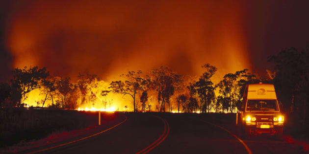 Bush fire at Arnhem Highway at night, Kakadu National Park, Northern Territory, Australia