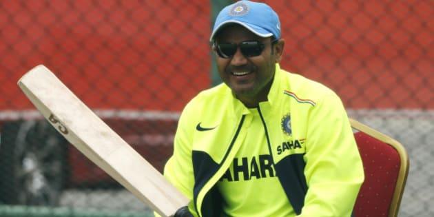 India's cricketer Virender Sehwag sits during a training session ahead of their  ICC Twenty20 Cricket World Cup match against Australia in Colombo, Sri Lanka, Thursday, Sept. 27, 2012 . (AP Photo/Eranga Jayawardena)