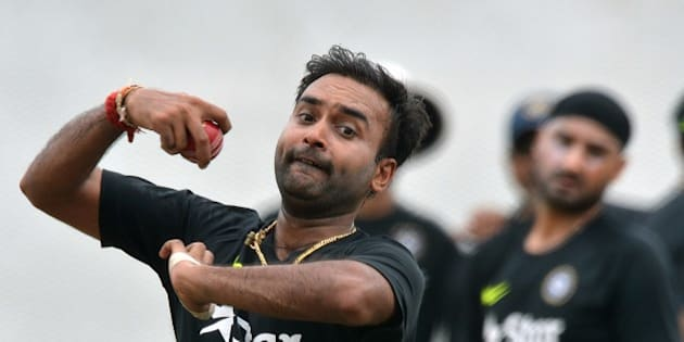 Indian cricketer Amit Mishra delivers a ball at a practice session at the R Premadasa International Cricket Stadium in Colombo on August 5, 2015. The first Test between India and Sri Lanka will be played on August 12 at the Galle International Cricket Stadium in Galle. AFP PHOTO/ Ishara S. KODIKARA        (Photo credit should read Ishara S.KODIKARA/AFP/Getty Images)