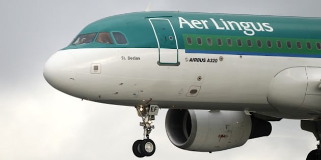 Aer Lingus Airbus A320 plane lands at Dublin airport, Ireland, Tuesday, Jan. 27, 2015. Aer Lingus said Tuesday it supports a takeover bid by British Airways parent IAG, putting the Irish national airline with its trademark shamrock tailfins on course for foreign acquisition nine years after its privatization.  (AP Photo/Peter Morrison) (AP Photo/Peter Morrison)