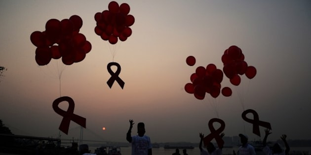 Indian social activists and children release ribbons and balloons during an event to mark World AIDS Day in Kolkata on December 1, 2014. According to the UN AIDS programme, India had the third-largest number of people living with HIV in the world at the end of 2013 and it accounts for more than half of all AIDS-related deaths in the Asia-Pacific region. In 2012, 140,000 people died in India because of AIDS. The Indian government has been providing free antiretroviral drugs for HIV treatment since 2004, but only 50 percent of those eligible for the treatment were getting it in 2012, according to a report by the World Health Organisation. AFP PHOTO/Dibyangshu SARKAR        (Photo credit should read DIBYANGSHU SARKAR/AFP/Getty Images)