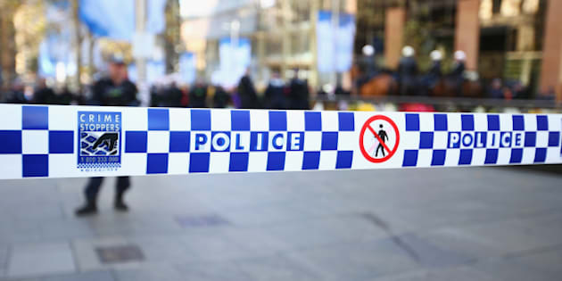 SYDNEY, AUSTRALIA - JULY 19:  Police tape is seen to control protestor movements as 'Reclaim Australia' protesters and counter protestors gather on July 19, 2015 in Sydney, Australia. 'Reclaim Australia' grassroots rallies are being held across Australia to protest the alleged 'Islamisation' of Australia.  (Photo by Mark Kolbe/Getty Images)