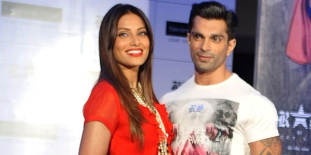 Indian Bollywood actress Bipasha Basu (L) poses with actor Karan Singh Grover during the launch of designer fashion brand 'RS by Rocky Star collection' in Mumbai on July 7, 2015.  AFP PHOTO/STR        (Photo credit should read STRDEL/AFP/Getty Images)