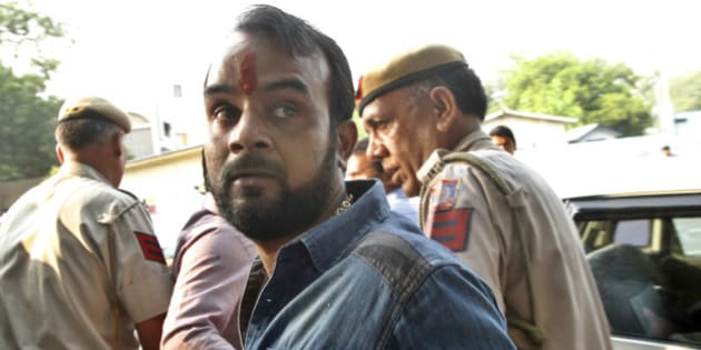 NEW DELHI, INDIA - OCTOBER 19: Alleged attacker who threw ink on Jammu & Kashmir MLA Engineer Rashid after he held a press meet to criticise a fire-bomb attack in Udhampur in which a youth from Kashmir died on October 19, 2015 in New Delhi, India. The Hindu Sena, a lesser known group, claimed responsibility for the attack. Rashid was recently beaten up by BJP MLAs inside the Jammu and Kashmir Assembly for allegedly hosting a beef party. (Photo by Arun Sharma/Hindustan Times via Getty Images)