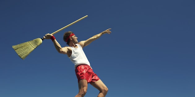 Nerdy man throws broom as javelin in his own special version of a track and field event