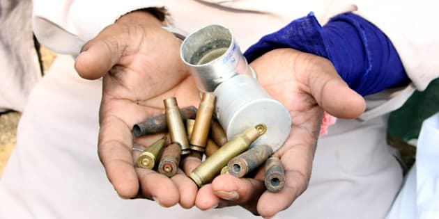 BATHINDA, INDIA - OCTOBER 20: A villager showing the shells of the cartridges fired by police during protest at Behbal Kalan on October 20, 2015 in Bathinda, India. The cops had allegedly fired over 100 rounds during the protest over the sacrilege of Guru Granth Sahib. Punjab is on the boil due to series of incidents of sacrilege of scriptures of Guru Granth Shib at seven places in the past one week which led to protests by Sikh organisations who blocked traffic at various places. (Photo by Sanjeev Kumar/Hindustan Times via Getty Images)