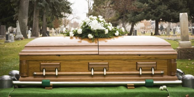 coffin at a cemetery