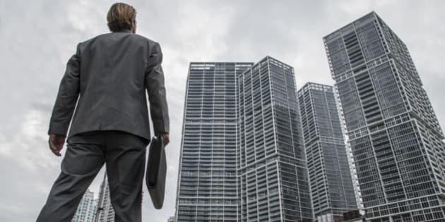 Businessman watching high building