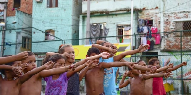 Children from the Sao Carlos Shantytown learn archery in Rio de Janeiro, Brazil on September 16, 2015. AFP PHOTO / CHRISTOPHE SIMON        (Photo credit should read CHRISTOPHE SIMON/AFP/Getty Images)