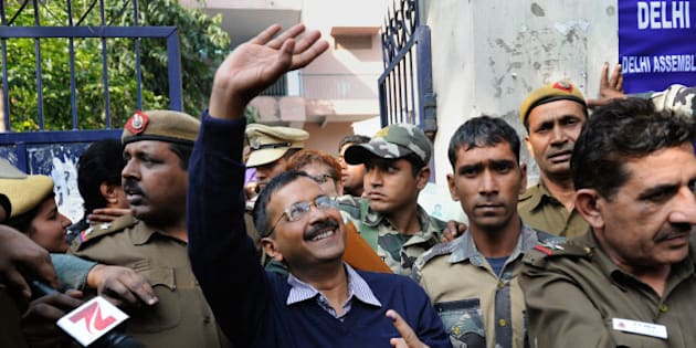 Aam Aadmi Party, or Common Man's Party, leader Arvind Kejriwal waves to residents as he comes out of a polling station after casting his vote in New Delhi, India, Saturday, Feb. 7, 2015. Voters cast ballots in the Indian capital on Saturday in an election that is seen as a litmus test for the popularity of Prime Minister Narendra Modi and his Hindu nationalist party. Opinion polls ahead of the vote to choose New Delhi's 70-member assembly suggest that Modi's Bharatiya Janata Party is either locked in a close contest with the upstart Common Man's Party or will come in second. (AP Photo/Altaf Qadri)