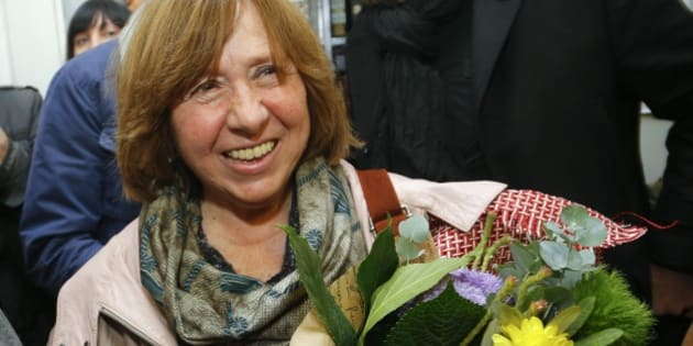 "Belarusian journalist and writer Svetlana Alexievich who has been named the 2015 Nobel literature winner, holds flowers as she leaves a news conference in Minsk, Belarus, Thursday, Oct. 8, 2015. Belarusian writer Svetlana Alexievich won the Nobel Prize in literature Thursday, for works that the prize judges called ""a monument to suffering and courage."" (AP Photo/Sergei Grits)"