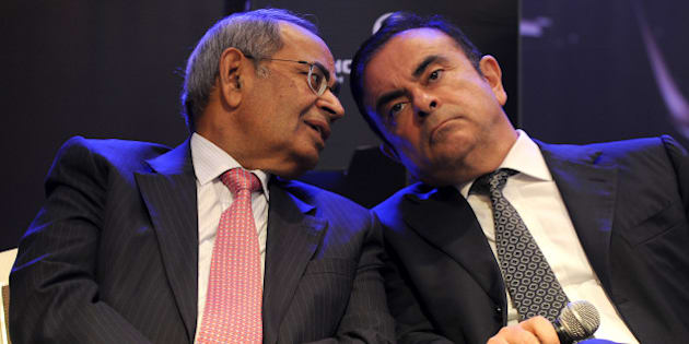 CEO and chairman of Renault-Nissan, Carlos Ghosn (R) and co-chairman of Hinduja Group, G.P. Hinduja share a point during the launch of Hinduja Group's flagship brand, Ashok Leyland's multi-purpose vehicle (MPV) 'STILE', in Chennai on July 16, 2013. 'STILE' was developed as part of the joint venture between Ashok Leyland and Nissan Motor Company. Ashok Leyland and Nissan Motor Company had inked a Master Co-operation Agreement (MCA) in October 2007 for vehicle manufacturing, powertrain manufacturing and technology development. Under the MCA, one of the joint ventures is to manufacture Light Commercial Vehicles (LCVs), in which Ashok Leyland has an equity stake of 51 per cent and Nissan 49 per cent. Stile is the second product offering from this joint venture. AFP PHOTO/Manjunath KIRAN        (Photo credit should read Manjunath Kiran/AFP/Getty Images)