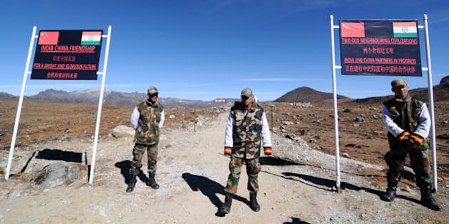 Indian Army personnel keep vigilance at Bumla pass at the India-China border in Arunachal Pradesh on October 21, 2012. Bumla is the last Indian Army post at the India-China border at an altitude of 15,700 feet above sea level. AFP PHOTO/ BIJU BORO        (Photo credit should read BIJU BORO/AFP/Getty Images)