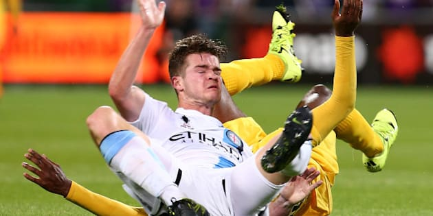 PERTH, AUSTRALIA - OCTOBER 21: Guyon Fernandez of the Glory brings down Connor Chapman of Melbourne during the FFA Cup Semi Final match between Perth Glory and Melbourne City FC at nib Stadium on October 21, 2015 in Perth, Australia.  (Photo by Paul Kane/Getty Images)